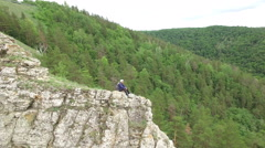 Rock climber on cliff Stock Footage