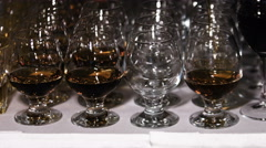 Glasses with cognac or brandy. Alcohol drink background Stock Footage