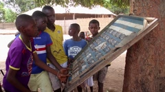 Africa native village children playing pinball game Stock Footage