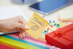 Thanks text on adhesive note - stock photo