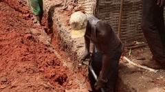Africa village man working in sanitation infraestructures Stock Footage