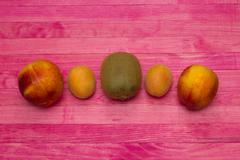Kiwi apricot and nectarine fruits Stock Photos