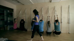 A group of young people performing the task of yoga Stock Footage