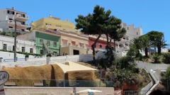 Traditional houses on a hillside overlooking the Portuguese coat. - stock footage