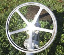 Big ball valve with a circular shape maneuver the plant management of multiut Stock Photos