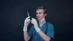 Doctor Preparing Syringe Arkistovideo