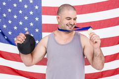 Athlete with olympic gold medal - stock photo