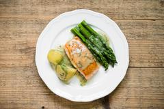 Grilled salmon with boiled potatoes and asparagus. Top view - stock photo