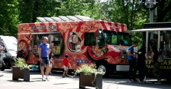 A food truck in the park Stock Footage