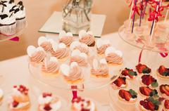 Delicious wedding reception candy bar dessert table Stock Photos