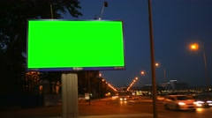 A Billboard with a Green Screen on a Busy Night Street - stock footage