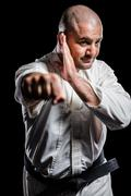 Fighter performing karate stance - stock photo