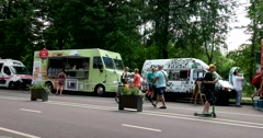 Colorful food trucks in the park Stock Footage