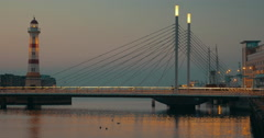 Bridge and lighthouse in the evening Stock Footage
