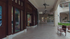 Outdoors mall scene with stores and fountain Stock Footage