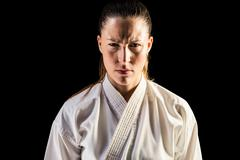 Female fighter on black background - stock photo