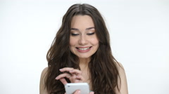 Woman talking on mobile with happy smile hearing good news - stock footage
