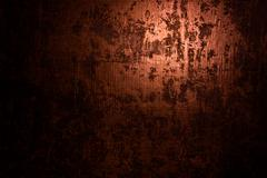 Dark old scary rusty rough golden and copper metal surface texture/background Stock Photos
