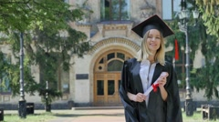 Graduand in Mantle is Looking For Someone Woman Shows Her Diploma Smiling and Stock Footage
