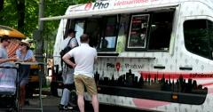Gray food truck in the park Stock Footage