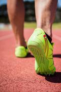 Athletes feet running on the racing track - stock photo
