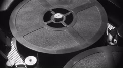 16 mm Film is Rotated in a Movie Camera - stock footage