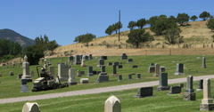 Cemetery headstones caretaker groundskeeper mow grass lawn DCI 4K - stock footage