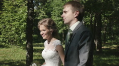 Newlywed couple walking in the Park Stock Footage