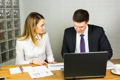 Male and female office workers Stock Photos
