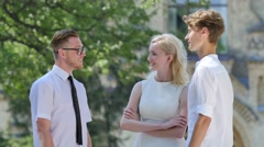 Three Friends Are Talking Smiling Gesticulating Courtyard of Old Building Park Stock Footage