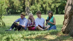 Students Under the Tree Preparing to Exams Outdoors Studying Reading Students Stock Footage