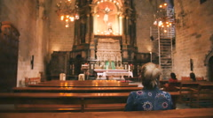 Woman on the bench in cathedral Stock Footage