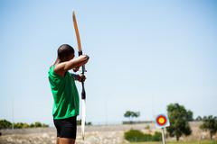 Athlete practicing archery - stock photo