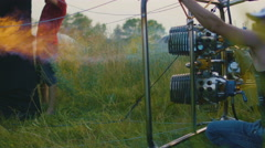 Hot air balloon burner firing and inflates the envelope, close up Stock Footage