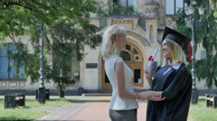 Young Woman Congrats the Graduand in Mantle Standing at the University Two Stock Footage