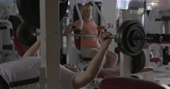 Two senior people training on fitness machines Stock Footage