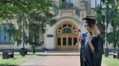 Young Woman is Hugging the Happy Graduand Student in Mantle is Walking Away Stock Footage