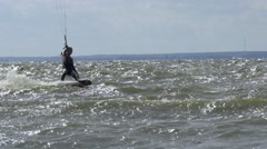 Young beautifil girl kiter riding in the clear waves. Tracking pan shot. Stock Footage