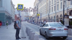 People crossing street in downtown Moscow, Russia Stock Footage