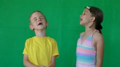 Two children trying to sing Stock Footage