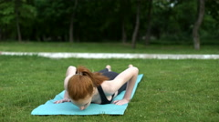 Girl practicing stretching exercises Stock Footage