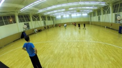 Teams play football in a spacious hall, view from above. Stock Footage