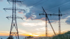 Time-lapse.  high voltage post. High-voltage tower on sky background . Sunris Stock Footage