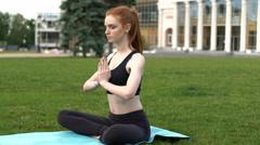 Redhead woman meditating in pose of lotus Stock Footage