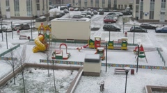Childrens playground in winter in a residential complex Stock Footage