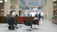 People sit and walk in the lobby of business center Preo-8 Stock Footage