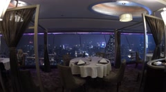 Two couples sitting at a table rotating restaurant. Stock Footage