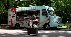 Beautiful blue food truck in the park Stock Footage