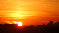 Silhouettes of houses of a modern city during sunrise. Time lapse. Stock Footage