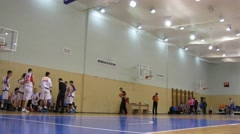 Players start game in basketball around the scoreboard Stock Footage